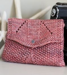 """Free Knitting Pattern for Sundance Bag - Clutch with flap in seed stitch. 7"""" wide x 4½"""" tall. Worsted weight wool yarn. Designed by Joëlle Meier Rioux. Pictured project by BetsyJo"""