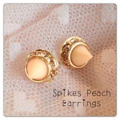 spike peach earrings $10