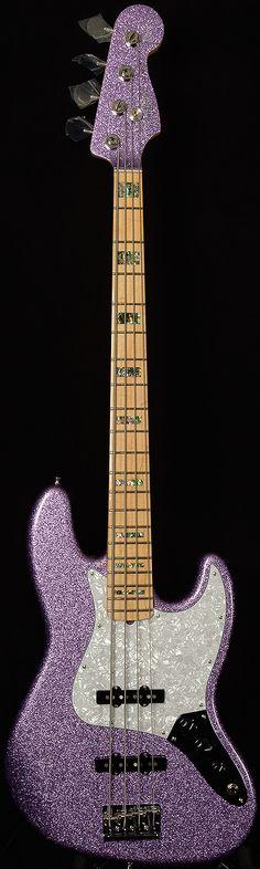 Fender Adam Clayton Signature J-Bass in a delightful purple sparkle finish.