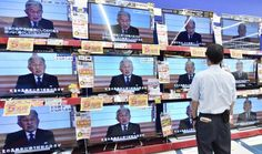 A man watches a speech by Emperor Akihito to the nation at an electronics shop…