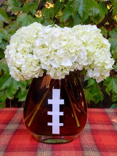 """clip a few flowers a festive centerpiece is easy… (I fill the clear vase with water and brown food coloring, then """"lace"""" it up with white duct tape)"""