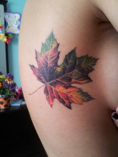 Very pretty - and unique - cover up tattoo design. Lovely autumn colours really brings it to life.