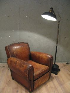 French leather club chair from 1930's Paris, so it made it through the occupation and, somehow, to the new world. It's beautiful. 1920's industrial machinist's floor light