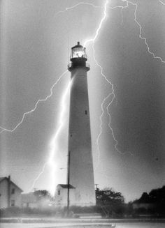 Something for budding Coast Guard Lighthouse Technicians to think about. :-) lightning strike at Cape May Point Lighthouse, NJ. Lighthouse Storm, Lighthouse Pictures, Beacon Of Light, Ciel, Belle Photo, Mother Nature, Beautiful Places, Cape May Point, Scenery
