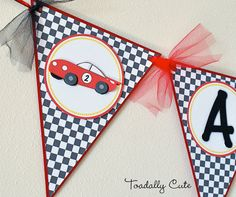 ZOOM into the fun with this race car, triangle pennant style banner. Banner includes 1 name up to 8 characters long and the age. For longer names or