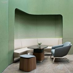 A wool-nylon and a polyester cover a feature wall in the lounge. Photography by Nicolas Mathéus.