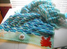 wavy shell crochet blanket -pattern at allfreecrochet.com added star fish, sand dollar, and crab to border