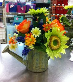 Fresh market collection watering can. Green sunflowers with oranges and yellows. Spring 2014.   Laura A.   Michael's Tulsa (9039)
