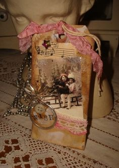 Altered Christmas Tag w/ Photo of Vintage Children Sledding Sheet Music Pink Wish. $3.50, via Etsy.