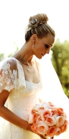 Bride's top bun with braid wedding hairstyle
