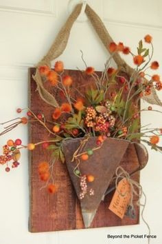repurposed junk - A rusty funnel flattened makes a great place for fall florals
