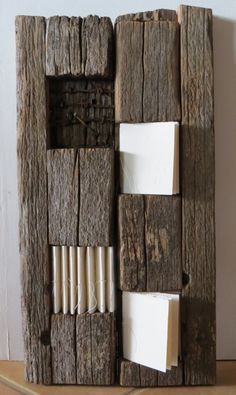 "Fiona Dempter, Paper Ponderings: My 2013 favourites: ""Old Posts hold stories"", worn wood and white books. Book Sculpture, Paper Sculptures, Found Object Art, Handmade Books, Book Making, Bookbinding, Home Decor Items, Wood Wall Art, Art Boards"