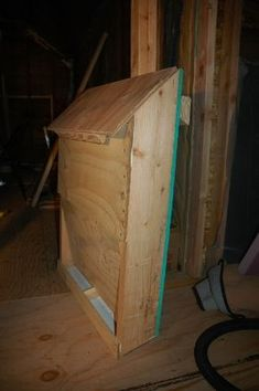 Chicken feeder that has separation for feed and oyster shell. Mount on inside large door for easy access.