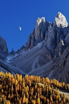 Rock needles with the Moon, Dolomites, Italy.