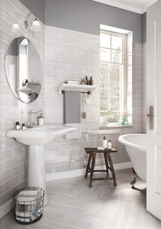There's something so serene about a monochromatic bathroom. The pale, silvery gray wall tile perfectly complements the faux-wood porcelain floors, the towel and wall paint are a perfect match. Wood Tile Shower, Wood Wall Tiles, Grey Wood Tile, Faux Wood Tiles, Porcelain Wood Tile, Wood Walls, Latest Bathroom Tiles, Grey Bathroom Tiles, Grey Bathrooms