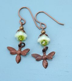 Bee Mine Earrings - Tiny brass bee dangles beneath a flower blossom created with brass, a Czech glass bead and a Swarovski crystal Seed Bead Earrings, Seed Beads, Drop Earrings, Flower Blossom, Bee Jewelry, Alcohol Ink Painting, Handmade Jewelry Designs, Czech Glass Beads, Designer Earrings