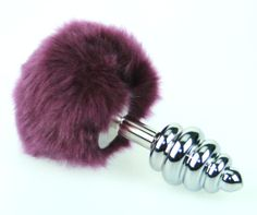 Small Bunny Tail Butt Plug!  Available in four colors.  This tail is synthetic. http://www.thekinkfactory.com/#!product/prd1/2379033131/bunny-tail-butt-plugs-with-small-plug-(synthetic)