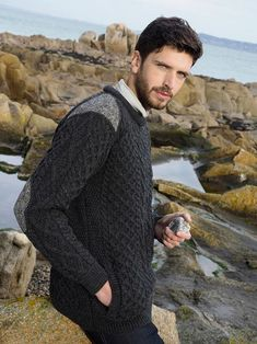 This Aran Sweater with Irish tweed detail is not only made from 100% merino wool it also features Irish tweed, detailed in the shoulders and elbows. Pockets to the front for extra comfort. a perfect addition to your casual wardrobe.