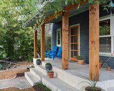 Landscape Design around Farmhouse Front Porch Landscaping and Front Porch Ideas to Add the Wow Factor Landscape Design around Farmhouse Front Porch. Do you want to make your front porch look inviti… Cedar Posts, Farmhouse Front Porches, House With Porch, Front Porch Decorating, Types Of Houses, Porch Design, Wood Columns, Porch Kits, Exterior