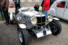MG TC in racing livery and bare metal finish.