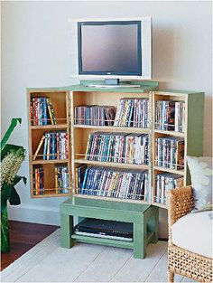 How to make a DVD cabinet: Hide all your DVDs, CDs and games in a cabinet that has a tiny footprint yet holds a huge library of discs. The unit holds 210 DVDs or 288 CDs in single jewel cases. The unit holds 210 DVDs or 288 CDs in single jewel cases. The shelves are spaced so that DVDs can easily be placed behind the retaining rods, and there's plenty of room for your DVD player or VCR underneath.