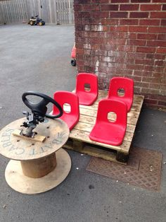 Fantastic resourceful idea to encourage socialisation and early language. Pallets, cable reel, unwanted chairs and a steering wheel makes a car, train or bus!