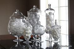 candy jars for beauty supplies - storage and organization plus it looks super cute