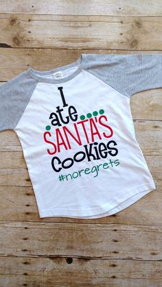 Got A Toddler? Youre gonna need this shirt! Cute {and sneaky} toddlers look adorable in our I ate Santas Cookies T-shirt. Perfect for Christmas Parties, Pre-school, Holiday Birthday, and Fun Family Photo Shoots. Heat Pressed shirts are machine washable and will stand up to toddler