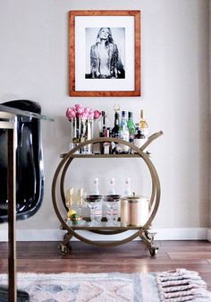 Bar cart stock & styling how-to, brass, 1970s, Kate Moss, black Panton chair, pink boho kilim rug