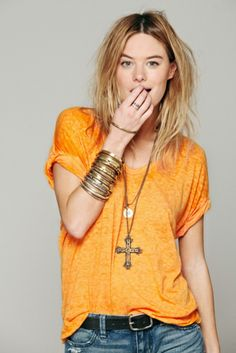 Free People Womens Keep Me Tee and wonderful gold accessories. Dead link but beautifully accessories. The arm full of bracelets really make this outfit. Now I have to make a trip to forever 21 for cheap gold bracelets!