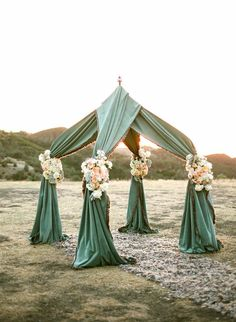 inspiration. get a small tent frame and drape a fabric of your choice across then dress up with flowers.