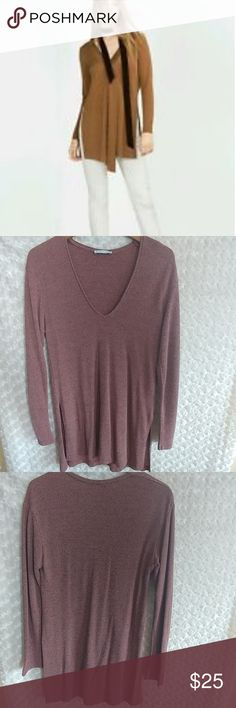 NWOT Zara Woman's Ribbed Slit Top New without tag. Never used. Size :M Looks great with some leggings Stock photos of how it looks are the last one's It's a beautiful orange brown color. Zara Tops Tunics