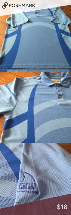 Tehama Men's Two Tone Blue Polo Shirt Two tone blue design polo shirt by Tehama. Created by Clint Eastwood and Nancy Haley of Sport Haley. Made of 100% polyester Hang 'Em Dry which wicks moisture and is anti-bacterial. Tiburon Naples logo on sleeve.       Has a few pills. Tehama Shirts Polos