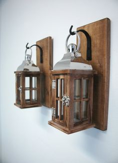 Wood and Glass lantern pair on stained knotty pine boards with wrought iron hooks rustic wall decor cabin decor on Etsy, $62.00