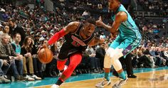 David Nwaba #11 of the Chicago Bulls handles the ball against Malik Monk #1 of the Charlotte Hornets on December 8, 2017 at Spectrum Center in Charlotte, North Carolina.