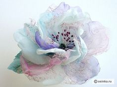 Gorgeous flower! All I can say is WOW. Tutorial is there too (used google to translate)