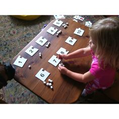 "Counting and Number recognition with marshmallows. My 3yo loves ""math with marshmallows"". She gets a sweet snack when done and they are small enough for her little hands!"