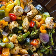 15 Minute Healthy Roasted Chicken and Veggies (One Pan) Recipe Main Dishes, Lunch with chicken breasts, bell pepper, onions, zucchini, broccoli florets, tomatoes, olive oil, salt, black pepper, italian seasoning, paprika