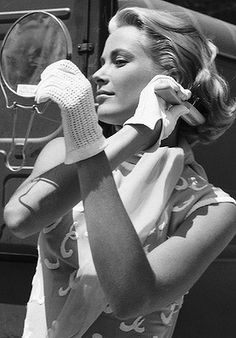 Grooming for success ... Grace Kelly captured in a private moment while filming To Catch A Thief.