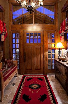 Love the red native carpet for this foyer entrance. #lovely #red #native…