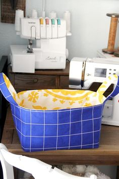 An easy sewing tutorial showing how to make a reversible fabric basket with handles, with free basket sewing pattern.