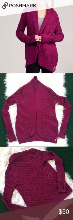 Ivivva by Lululemon Knit Cardigan Wrap Burgundy 12 The perfect sweater! Officially named Breathe Relax Love Wrap. Layer this sweater wrap over your dance outfit on your way to rehearse choreography with friends. Cotton knit is naturally breathable and super soft against your skin. Side pockets keep your phone and lib balm close at hand. Loose fit body gives you plenty of room to layer. Thumbholes help keep sleeves down and palms warm. Girl's size 12. Garment is in EUC. Please offer or ask…