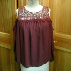 Beautiful cranberry colored blouse with lace! This is a beautiful new without tags cranberry blouse with open shoulders and lace. Great for the holidays! Tagged large but runs smaller so will fit medium or large Tops Blouses