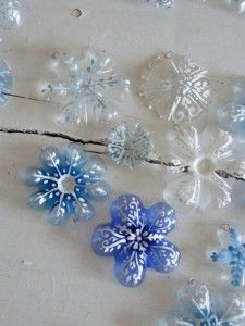 Cut off the bottoms of soda bottles. Paint with acrylics. Make a garland or string several together in a hanging strand.