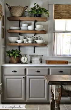 Grey kitchen with exposed wooden open shelving
