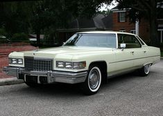 76 Cadillac Sedan deVille, showing the massive grillwork, bumper and quad headlights that defined these full size cars. In Phoenician Ivory.