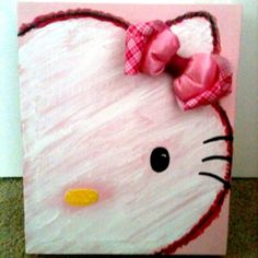 DIY Hello Kitty canvas art--- my sister would love this for her room!!!