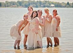 Bridal party in the water - fun wedding day shot for lake or ocean weddings