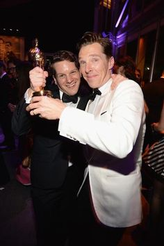 2015 ACADEMY AWARDS ~ Graham Moore and his Oscar for Best Adapted Screenplay for THE IMITATION GAME (2014), with Best Actor nominee Benedict Cumberbatch, who starred as Alan Turing in the film.