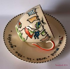"""Charlotte Rhead  """"The Maid was in the Garden""""   Crown Ducal Nursery Ware Cup & Saucer 1930's   eBay Sale £116 #crown_ducal #charlotte_rhead   http://www.pinterest.com/anniesland01/rhead-family-ceramics/"""